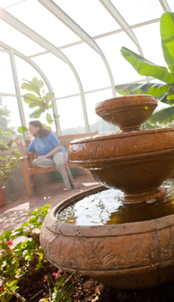 A Hopewell resident finds reflects quietly in the Cutler Conservatory mediation garden.
