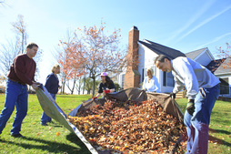 Residents help rake leaves on an autumn day at Hopewell Therapeutic Farm
