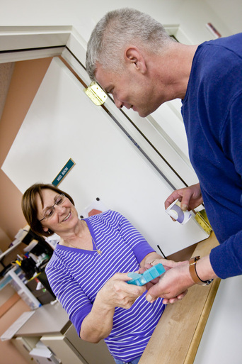 Hopewell staff help residents with their medication
